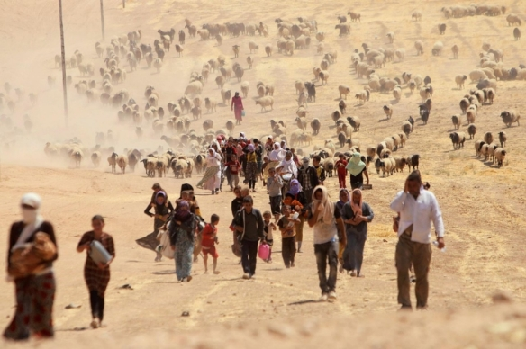 Yazidis flee from ISIS toward the Syrian border. Image via Al Jazeera